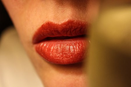 Photo for Lips behind the glass of white wine. - Royalty Free Image