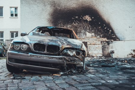 Totally incinerated burnt out luxury sedan in a sc...