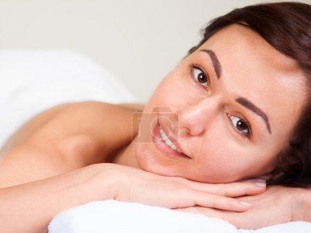 Closeup portrait of attractive woman enjoying day spa in luxury beauty salon