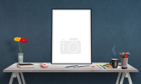 Isolated poster frame on office desk for mockup. Water colors, pencils, glasses, flowers, cup of coffee on table.