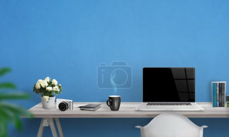 Photo for Laptop with blank screen on office desk. Free space on wall for text. Blue wall in background. - Royalty Free Image