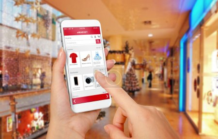 Smart phone online shopping in woman hand during Christmas