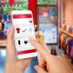 Smart phone online shopping in woman hand. Shoppin...