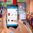 Smart phone online shopping in man hand. Shopping ...