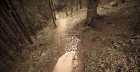 finding the right position in the forest with a compass, vintage