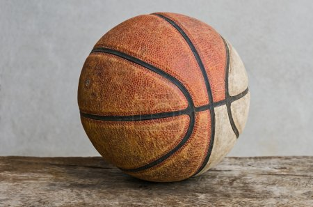 Old basketball on table