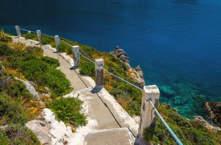 White stairs to divers bay on Greek coast, Greece
