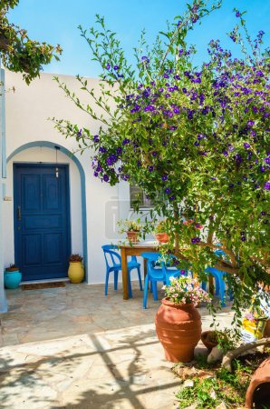Entry to typical Greek house, blue doores , Greece