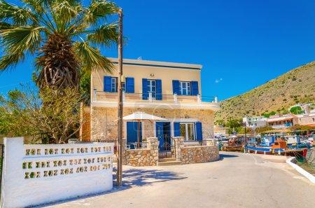 Greek house with blue wooden windows, Greece