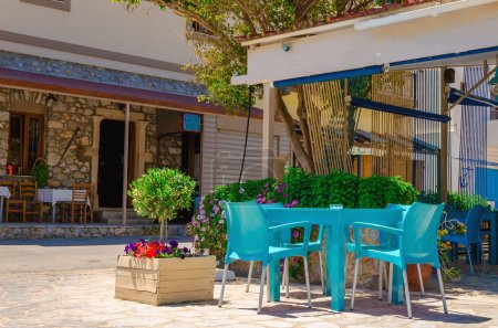 Traditional Greek restaurant with blue chairs