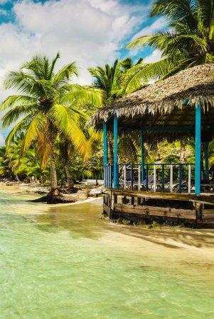 Beach hut on coast,  Caribbean Islands