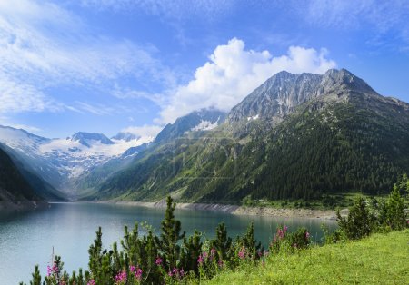Crystal clear alpine lake Schlegeis with colorful ...
