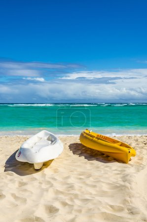 Kayaks on the sandy Caribbean beach
