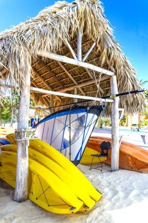 Sailing boats and kayaks on the Caribbean beach