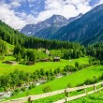 Beautiful alpine landscape with green meadows, alp...