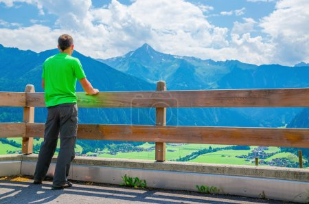 Young tourist and alpine landscape, Austria, Alps
