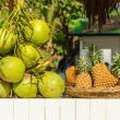 Постер, плакат: Stand with coconuts and pineapples