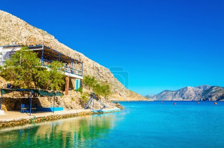Greek house with terrace over sea bay, Greece