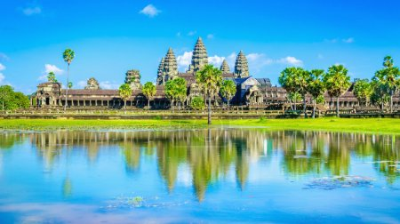 Angkor Wat temple and palms reflection, Cambodia