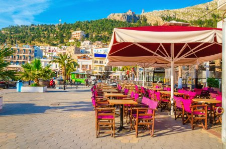 Purple chairs and umbrella in Greek restaurant