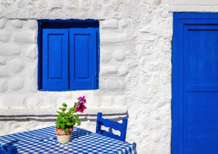 blue table with wooden chairs , Greece