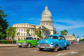 Classic American cars and Capitol in Havana