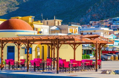 Colorful restaurant with red chairs, Greece