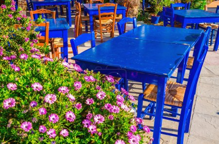 Blue tables in colorful Greek restaurant