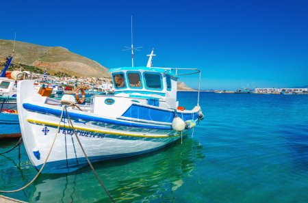 White-blue boat with Greek colors