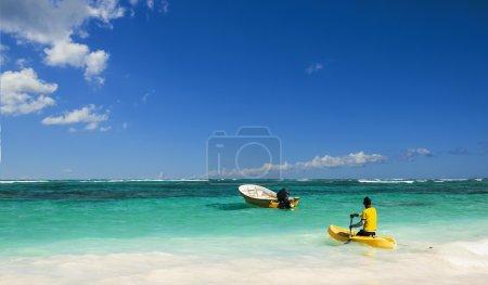 Man floating on canoe