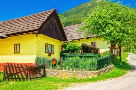 Wooden yellow hut and street