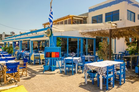 Blue wooden tables and chairs in Greek restaurant