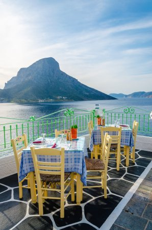Restaurant and tableclothes in Greek colors