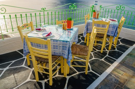 Tables at Greek restaurant with tablecloths