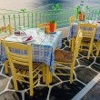 Tables at Greek restaurant with tablecloths nation...