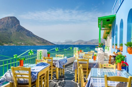 Panoramic view on typical Greek restaurant with fl...