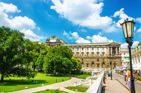 The Burggarten with statues and palm house, Vienna, Austria