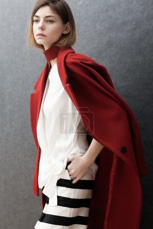 beautiful  woman in coat posing