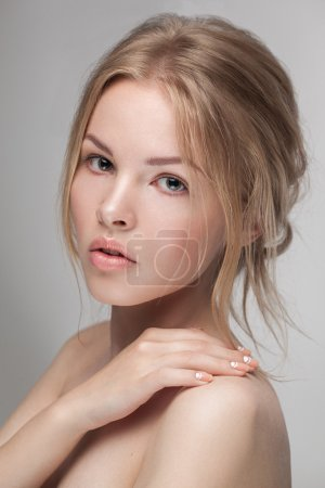 Natural fresh pure beauty portrait closeup of a young attractive model woman posing in studio looking at camera.