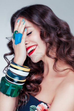 Beautiful attractive caucasian girl with brown chocolate shiny hair and red lips smile.