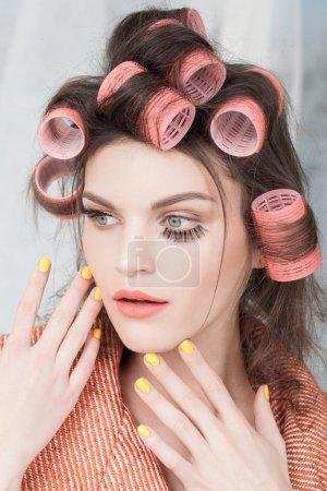 woman in hair curlers posing
