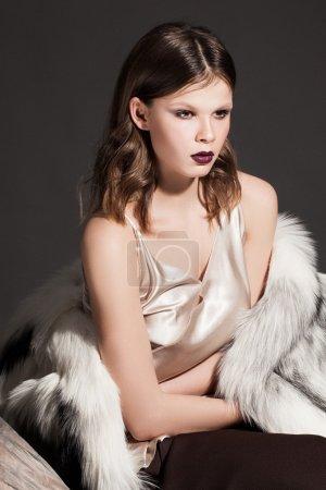 model in fur coat posing
