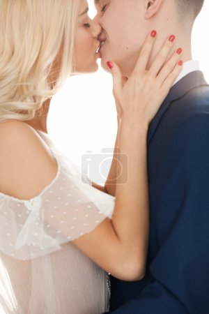 young woman and man kissing