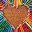 Heart shape made of colored pencils...