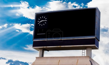 scoreboard at football stadium with sky with Clouds and Sun Rays