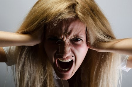 Photo for Very angry woman screams - Royalty Free Image