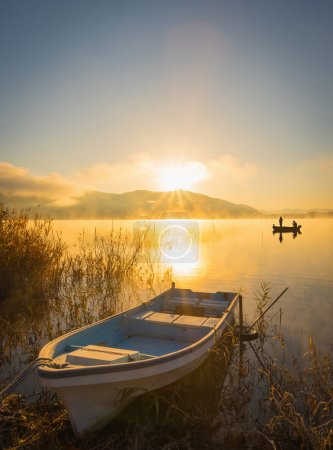 Boats on the lake Kawaguchiko, sunrise,People fishing on a boat,