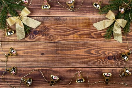 Christmas garlands on a wooden background with a place