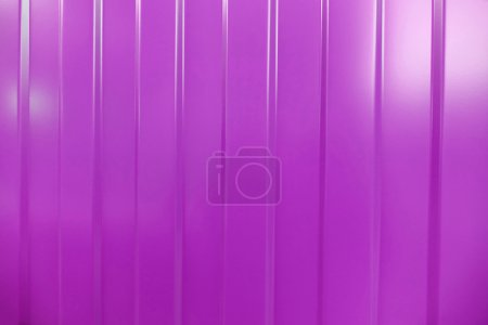 Corrugated iron is new. Texture color. Background pink.