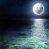 Big moon over the ocean. Seascape and moonlight. A high resoluti